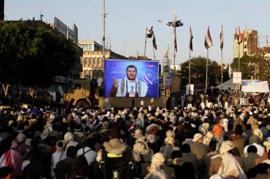 Shi'ite Houthi rebels watch a televised speech by their leader Abdul Malik al-Houthi