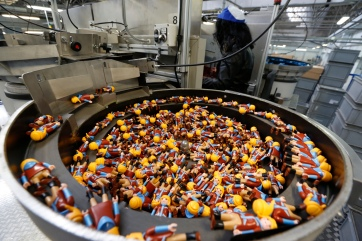 Playmobil figures are seen on the production line at the Playmobil Malta factory in the Hal Far Industrial Estate outside Valletta